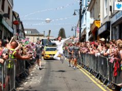 Dutch synchrone swimming coach Nadine Struijk carrying the Olympic Flame during the torch relay through Wales - May 2012